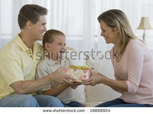 stock-photo-father-and-son-giving-a-gift-to-mother-19888924
